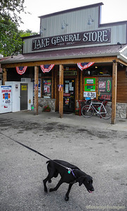The Lake Village General Store and an impatient pup trying to ham it up on its walk.