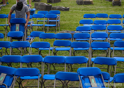 Time to pull and stack the chairs from the preferred-seating section of the KCQ Country Music Fest after the concerts are over and the 110,000 fans have left Ojibway Island.