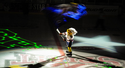 Sammy Spirit parades the Spirit flag at mid-ice before the start of playoff Game 3. Day #28.