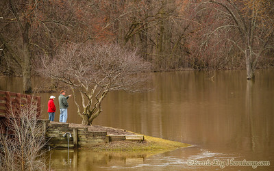 A Zilwaukee couple survey the flooded Chippewassee Park in downtown Midland. Day #47.