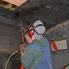 Grady Smith riveting the roof of the Climax cab in June of 2005.
