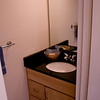 Half bath, matching granite countertop with Maple cabinet vanity