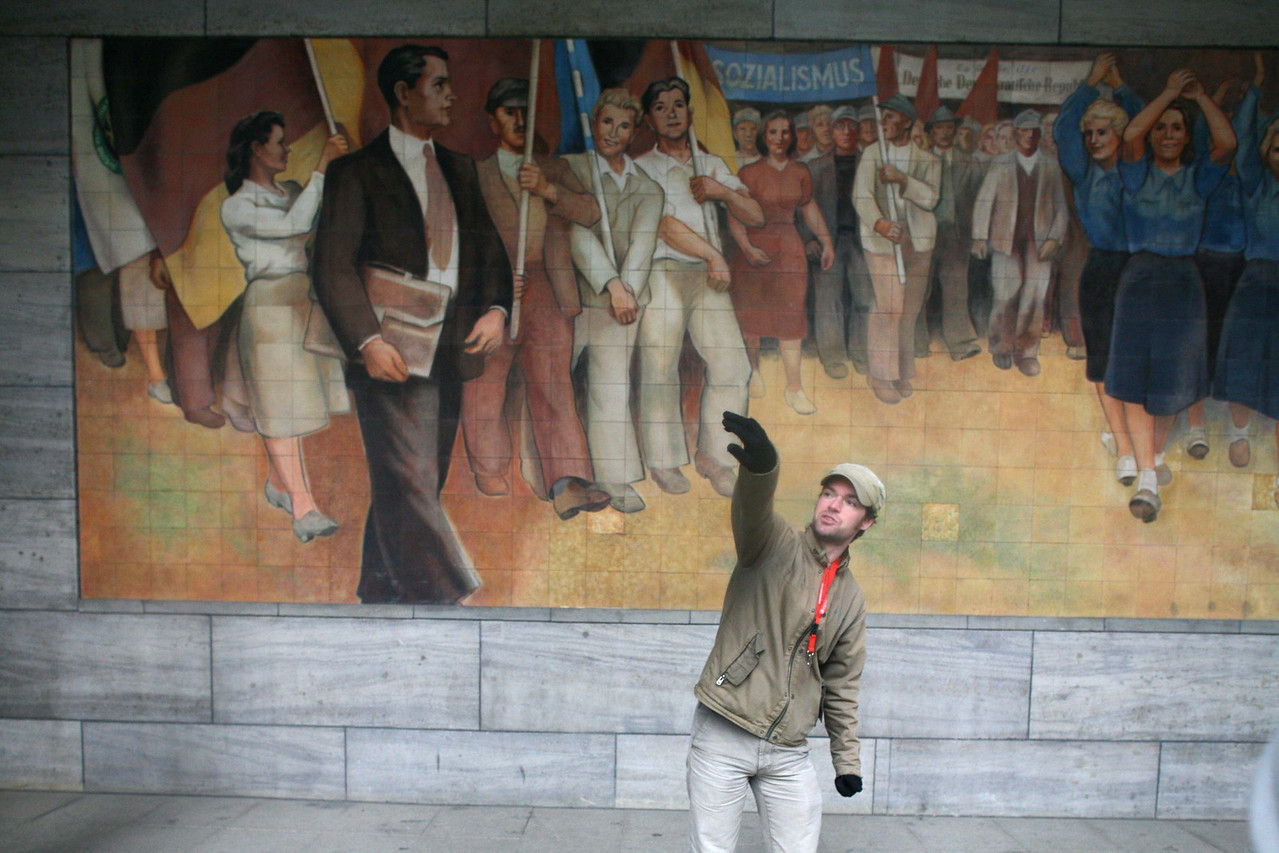 Our guide in front of a socialist mural.