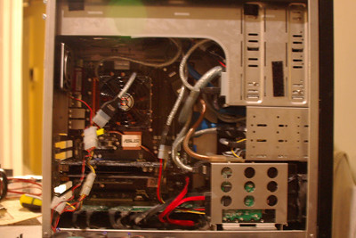 New board inside existing case.  This new setup is actually more spacious. The red wire is for the new 300GB maxtor.