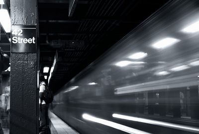 I really enjoyed this one.   I took the shot right where the light for the train starts.  The blur effect is from the train passing me from the pictures left to right.  So you can see through it because of the long exposure.  I was using B&W ISO 100 film.