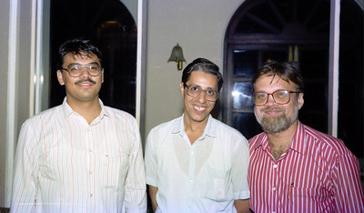 """Peter Theobald, Aspi Medhora and Harsh Javeri. Celebrations at the launch of """"War on Virus"""" Book Cover. A book by Harsh Javeri & Suchit Nanda for MUC (Microcomputer Users Club) and published by Computer Bookshop."""