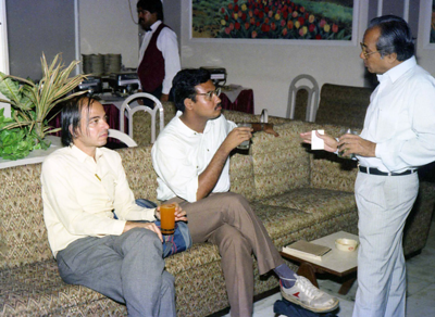"Members of press talking with Harshad Patel. Celebrations at the launch of ""War on Virus"" Book Cover. A book by Harsh Javeri & Suchit Nanda for MUC (Microcomputer Users Club) and published by Computer Bookshop."