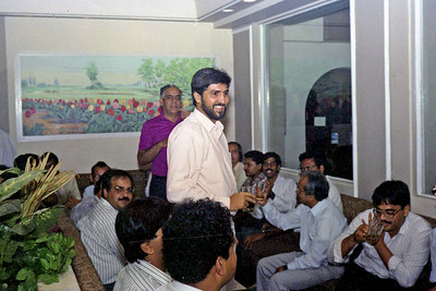 "Aziz Shroff offering a toast (Computer Bookshop) at launch of ""War on Virus"" Book Cover. A book by Harsh Javeri & Suchit Nanda for MUC (Microcomputer Users Club) and published by Computer Bookshop."