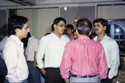 "Suchit Nanda and Peter Theobald with back of Harsh Javeri. Celebrations at the launch of ""War on Virus"" Book Cover. A book by Harsh Javeri & Suchit Nanda for MUC (Microcomputer Users Club) and published by Computer Bookshop."