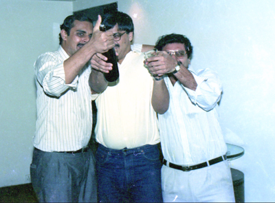 """Ashwin Mehta, Peter Theorbald & Harsh Khatau. Celebrations at the launch of """"War on Virus"""" Book Cover. A book by Harsh Javeri & Suchit Nanda for MUC (Microcomputer Users Club) and published by Computer Bookshop."""