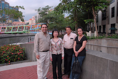 Suchit, Jian, Felix and Patricia on the walk back to the Hotel and about to cross the Singapore River