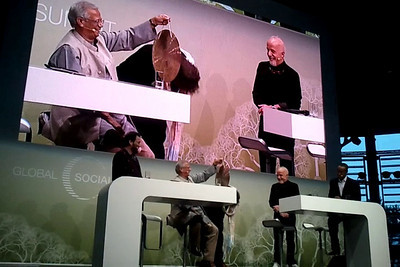 """Shekhar Kapur signing contract for """"Paani"""" - a Social Business with Nobel Laureate Prof. Muhammad Yunus, at the Global Social Business Summit 2010, held in Autostadt, Wolfsburg, Germany. Moderator Hans Reitz of Grameen Creative Lab GmbH.   http://www.gsbs2010.com/"""