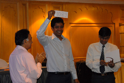 "Mahesh Sir holding up the ""magic"" figure of 1089 given by Dr. Pai . MT Educare Stategic Planning Workshop at Taj Residency, Nashik on 4th Oct 2007."