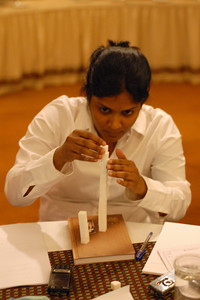 Sindu (Aven) working hard at making the world's tallest sugar cube structure at MT Educare Stategic Planning Workshop at Taj Residency, Nashik on 4th Oct 2007.