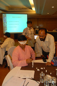 Setting the sugar cube columns at MT Educare Stategic Planning Workshop at Taj Residency, Nashik on 4th Oct 2007.