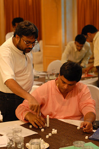 Murli Sir being helped by Chandresh Sir at MT Educare Stategic Planning Workshop at Taj Residency, Nashik on 4th Oct 2007.