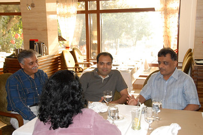 Kamlesh, ML (Mohammed Lokhandwala) and Anu listen to Sudhir's stories about travel in Europe.