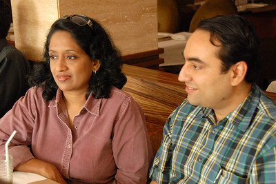Anu and Suchit listening to Sudhir's experience of traveling in Europe and how he recovered his bag from a thief on the train.