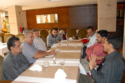 The group listening to Vipul-Gyan. Around the table from left, Ashwin Khandwala, Dinyar Lala, Harsh Javeri, Saumil shah, Kushal Shah (hidden), Mayur Jarmawala, Parvez Diwan and Vipul Shah.