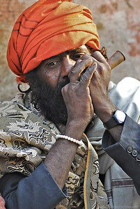 Sadhu smoking, Haridwar, India
