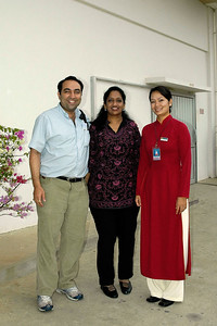 Anu & Suchit in Ho Chi Minh City (HCMC), Vietnam 2005 with the flight attendant of Vietnam Airways.