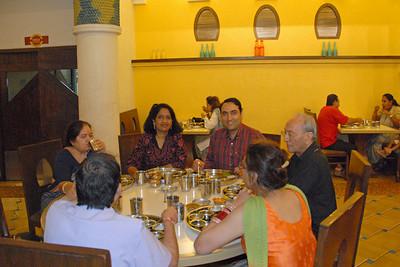 Around the table, Anu, Suchit, Papa, Chetna, Anish and Amma