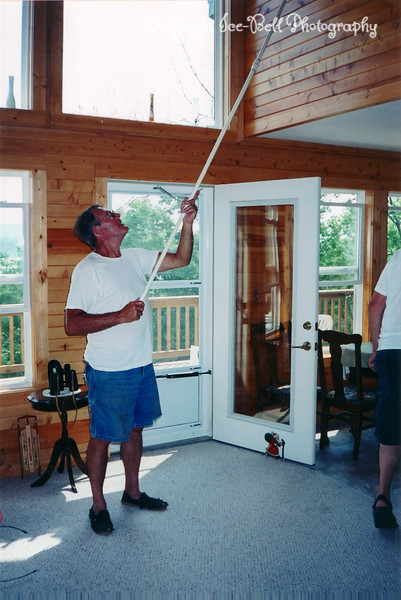 2004 Richard Opening the upper windows at the lake home