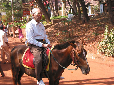 Papa on  a horse in Matheran.  Trip to Matheran to take parents out on a forced-holiday by their children. :)