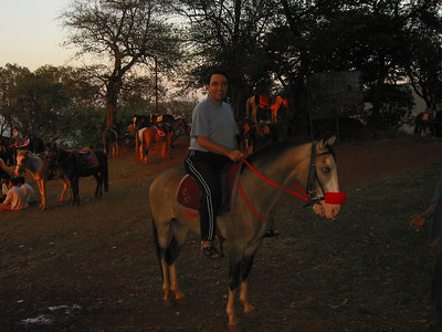 Suchit riding a horse at Matheran.  Trip to Matheran to take parents out on a forced-holiday by their children. :)