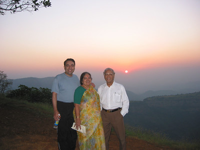 Setting sun behind Papa, Amma & Suchit at Matheran.  Thanks Anu for the picture.