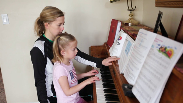 Robyn learning some piano from mom