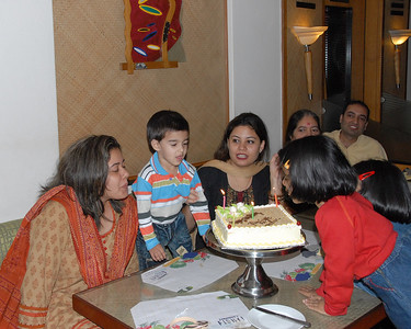 The cake arrives but the kids are ready to blow out the candle before the B'day girl!