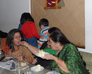 Ok the kids are not looking, lets quickly feed Priya the cake with all our fingers and all our love.