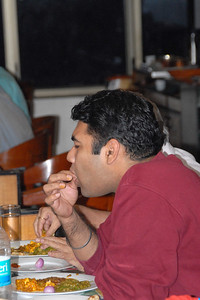 Piyush with the finger-licking-good food. Is that Paneer? :)