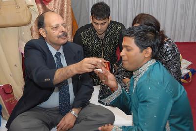 Priya's mama Anil Malhotra feeding Sumit. Priya Seth and Sumit Dargad's wedding in Mumbai (Bombay), Maharashtra, India. December 2007.