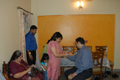 Vandana tying rakhee to Suchit. Thanks Anu for the pictures. Rakhi Celebrations held at Priya & Piyush Seth's home in Romy Apartments, Marol, Mumbai on 28th Aug 2007.