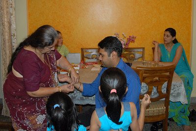 Amma tying rakhee to Piyush. Rakhi Celebrations held at Priya & Piyush Seth's home in Romy Apartments, Marol, Mumbai on 28th Aug 2007.