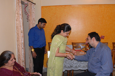Priya tying rakhee to Suchit. Thanks Anu for the pictures. Rakhi Celebrations held at Priya & Piyush Seth's home in Romy Apartments, Marol, Mumbai on 28th Aug 2007.