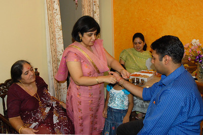 Vandana tying rakhee to Piyush. Rakhi Celebrations held at Priya & Piyush Seth's home in Romy Apartments, Marol, Mumbai on 28th Aug 2007.