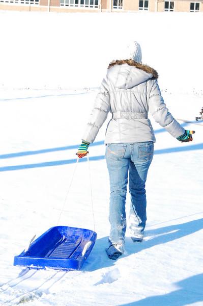 Rilye sledding with Mom