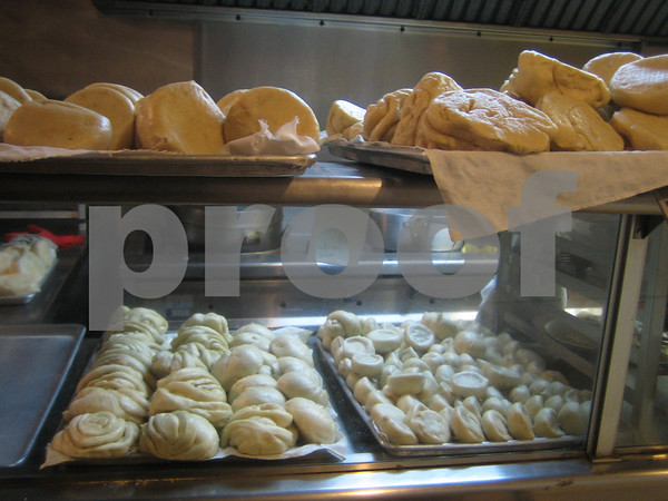 Sometimes I envy the cozy little bun in the display case.  ShanDong Dumplings, Oakland