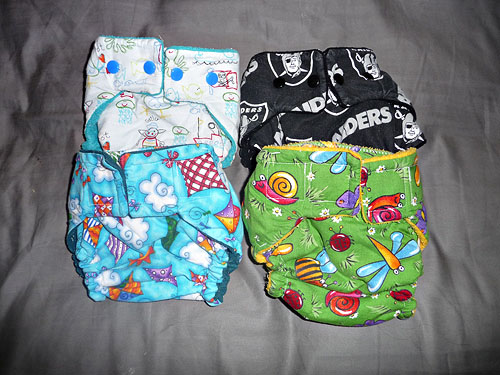 Wiggle Worm Bottoms covers, size small.  Raiders cover is microfleece, Kites is suedecloth, other 2 are fleece.  These were only used a couple of times each.  $6PPD each, or all for $20.