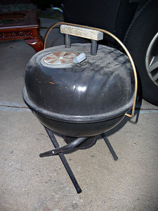 Portable charcoal grill.  $5