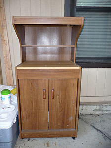 Microwave/kitchen hutch.  $15