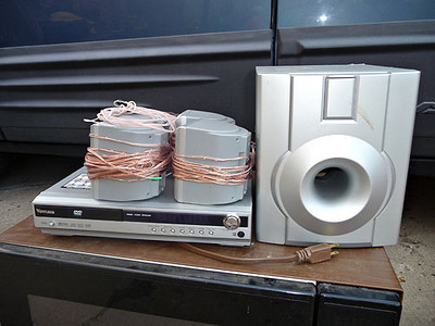 Venturer home theatre system with DVD player.  Works, but disc tray sticks a bit at times.  $25