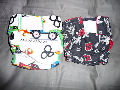 Wiggle Worm Bottoms pockets.  Black is size small, Trucks is medium, I believe.  Black one was a cover but I modified it to be a pocket.  Black inner is suedecloth, Truck inner is fleece.  These were used *maybe* twice each and are in EEUC.  $6 each or $10 for both.