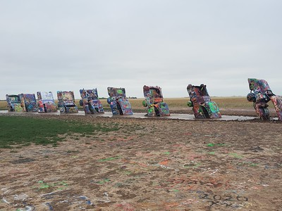 Cadillac Ranch early Sunday morning, just outside Amarillo, TX.  It was cloudy and cool and the wind was blowing so hard you had to lean into it to walk.  We didn't stay long.