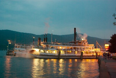 "This was a shot of the ""Mine Ha Ha"" boat we are taking later that night to watch fireworks.  Info: The Mine-Ha-Ha is a steamship that cruises on Lake George, New York. The ship derives its power from steam, which turns a paddle wheel on one end of the ship (shown above)."