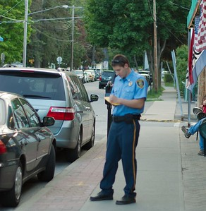 """Here the police do what they do best, keep """"order"""" by ticketing people.  They have to get paid don't they?"""