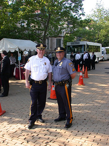 This photo was taken by Doris Schultz           In the photo (From left to right): Police officer with white uniform,and Police officer with blue uniform.